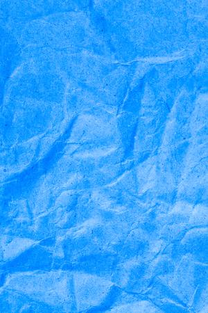 Blue vignette crumpled paper. Stock Photo