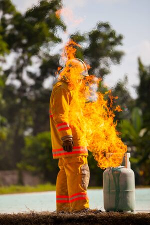 Firefighter with fire and suit for protect fire fighter for training firefighters.