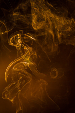 Gold smoke on black background.
