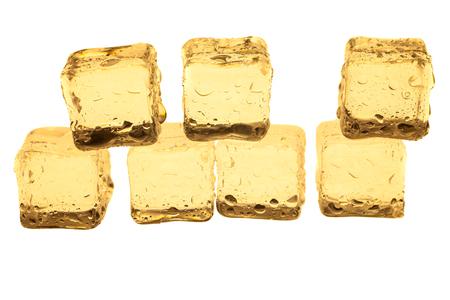 Golden ice cubes on white background. Stock Photo