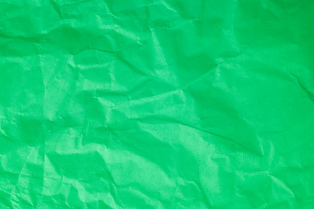 Green crumpled paper background.