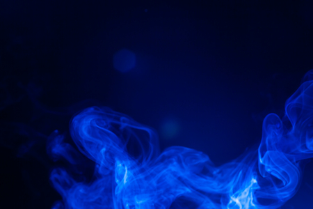 Blue smoke on black background. Stock Photo