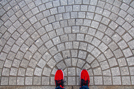Top view red shoes and tiled floors, shopping streets in Japan. Stockfoto