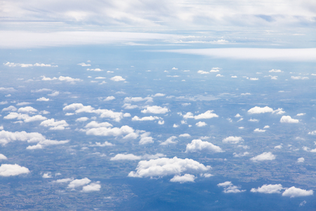 Clouds, sky and ground, looking from the plane.
