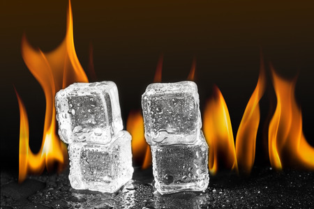 ice cubes flame fire background. Stok Fotoğraf