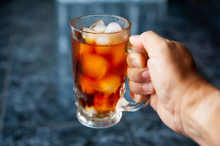 Cool americano, coffee, ice cubes, glass.