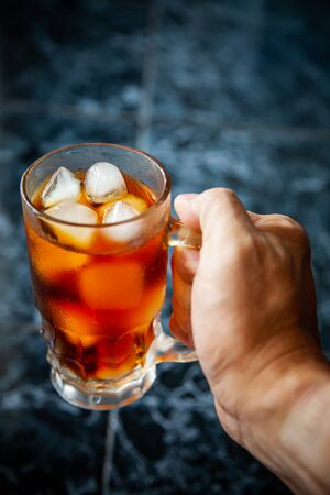 Cool americano, coffee, ice cubes, glass. Banco de Imagens - 127921553