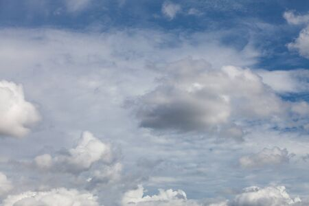 Blue sky background with clouds. Banco de Imagens