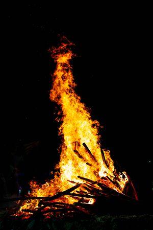 Bonfire that burns on a dark background, wood burning flame. Reklamní fotografie