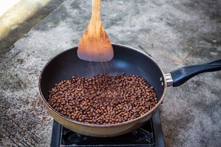 Traditional roasting coffee at home,  freshly roasted coffee beans.