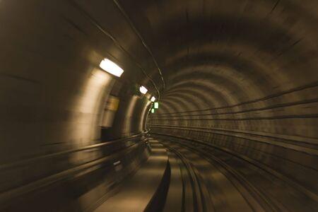 transportaion: Blurred motion in metro tunnel. Copenhagen metro