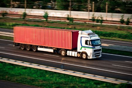 Freight truck on motorway. Container handling Stock Photo