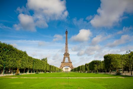 The Eiffel Tower in the morning with some clouds in the sky. Summer time Stock Photo - 4936211