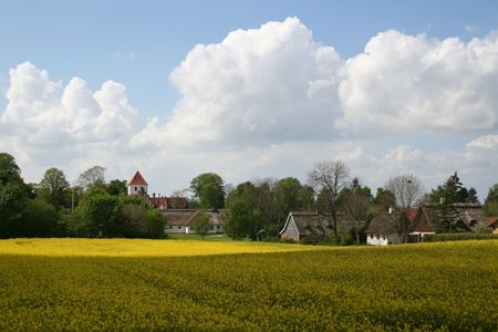 Countryside in Denmark in sunny and cloudy day photo