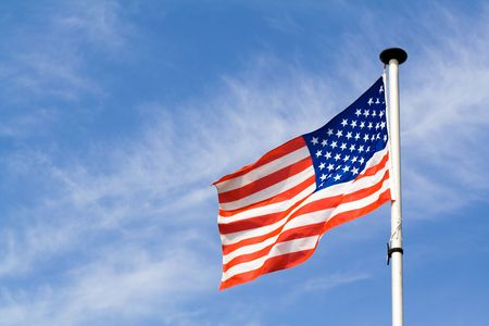 flagpoles: Waving american flag on blue sky background Stock Photo