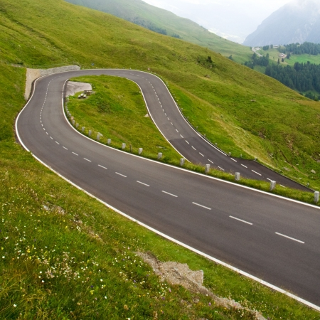 winding road: A curve of a high alpine road in Austria Stock Photo