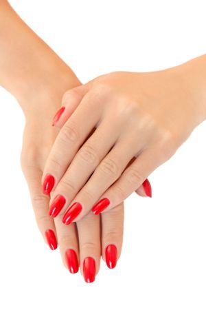 Hands of a young women.  Red nail polish photo