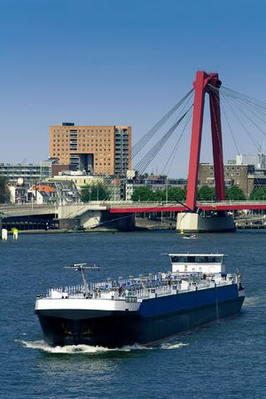 maas: Rotterdam. Maas river and a cargo ship. Willemsbrug on the background