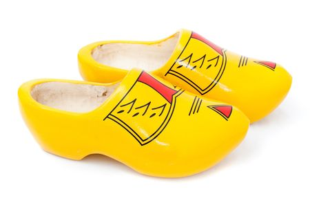 klompen: Pair of wooden shoes - klompen. Traditional dutch footwear for farmers. Isolated on white background