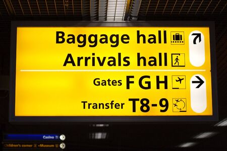 Information sign in airport. Baggage and arrivals halls directions Stock Photo - 5681327