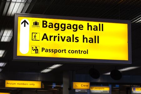 schiphol: Information sign in airport. Baggage and arrivals halls directions Stock Photo