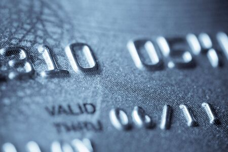 expire: Macro shoot of a credit card. Digits in focus. Can be used as a background Stock Photo