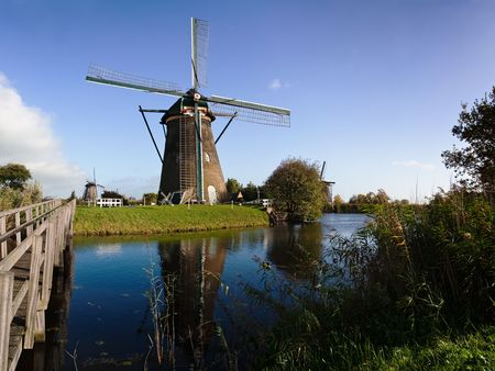 Traditional dutch windmill in famous Kinderdijk, The Netherlands photo