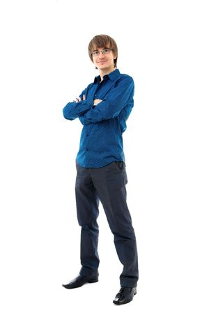 Young man standing. Wearing shirt and trousers. Isolated over white photo