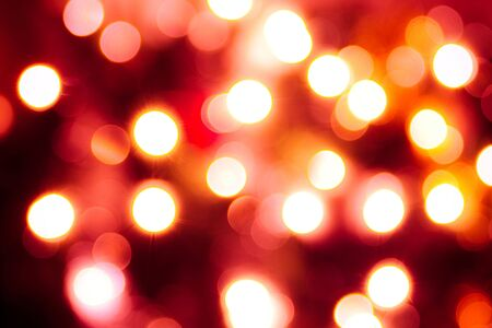 Abstract background of vivid round lights. Red tint Stock Photo - 6110738