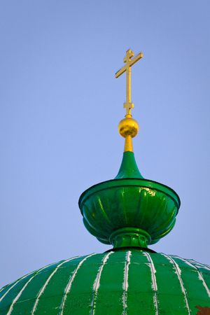 gold cross: Green dome and gold cross. Christian church