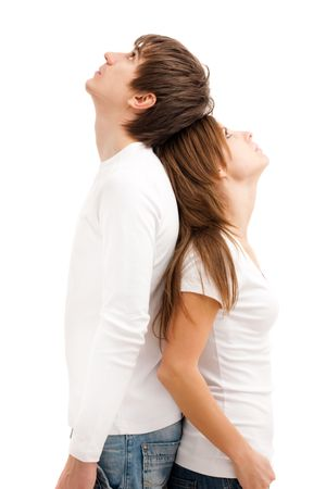 quarrel: Young couple standing, looking up and dreaming Stock Photo