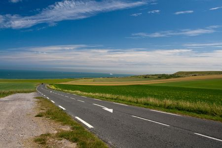 coutryside: Road in coutryside. Sea on the horizon Stock Photo