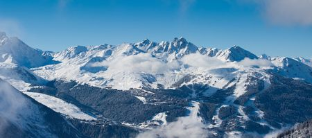 distant: Distant view on the Courchevel. Ski resort in French Alps. Panorama Stock Photo