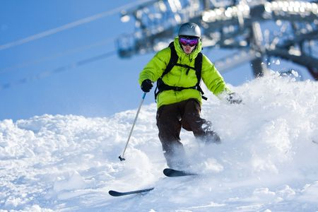 offpiste: Young man on skis out of slopes. Off-piste skiing