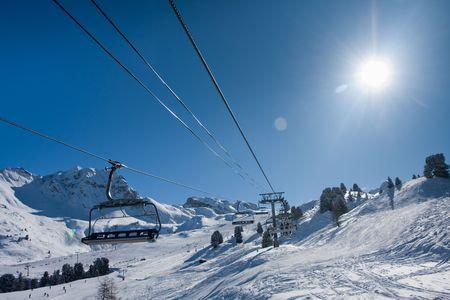 Chairlift on ski resort. Going up