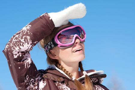 chearful: Young girl wearing ski mask on winter resort in Alps