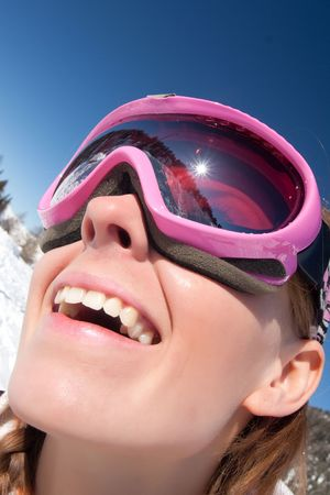 chearful: Funny close portrait of a young girl in ski mask