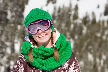 Young sporty girl wearing ski mask and hat. Winter vacation in Alps photo