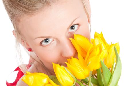 Young woman with bunch of tulip flowers. Isolated over white photo