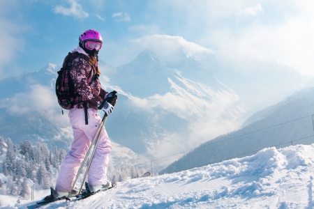 snow ski: Woman with skis on the top of the mountain. Skiing in The Alps