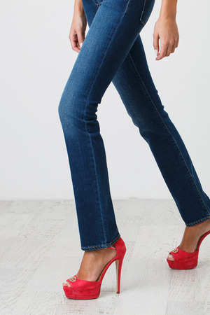 skinny jeans: Woman in blue skinny jeans and high heel shoes