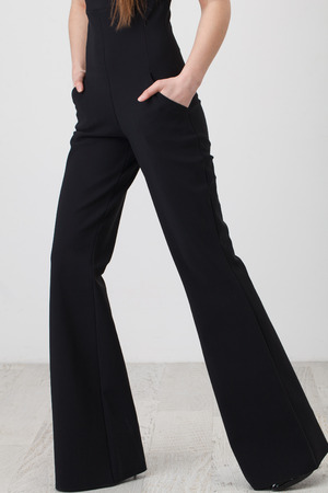 black pants: Woman in black pants on white background