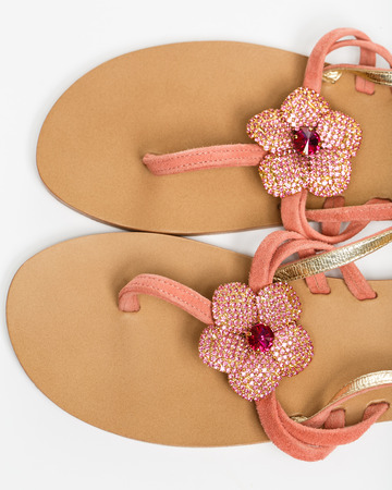 foot ware: The woman summer sandals isolated on a white background