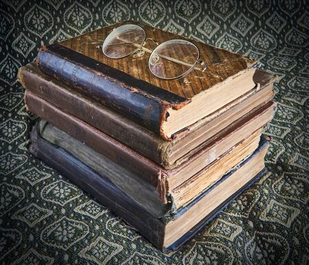 composition of old books and glasses in a stack background 스톡 콘텐츠
