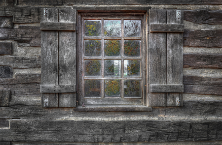 Old, histoprical window from old, wooden cabin house