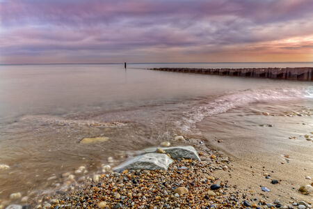 Lonely breakwater on Lake Michigan during colorful Autumn time