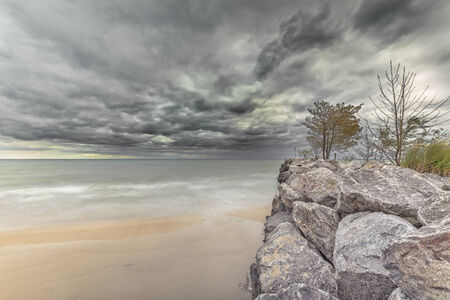 brink: Lonely breakwater on Lake Michigan during colorful Autumn time