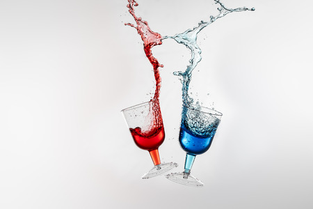 liquors: Dancing lasses with colorful liquors making liquor splash