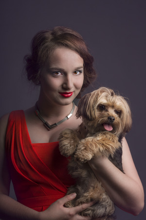 yorky: Portrait of queen in red dress with yorky dog.