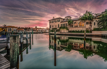 Colorful sunrise over Venetian Bay at Naples, Florida